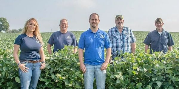 Contact information, White Front Feed & Seed employees standing in bean field