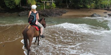 Horseback riding on the beach.