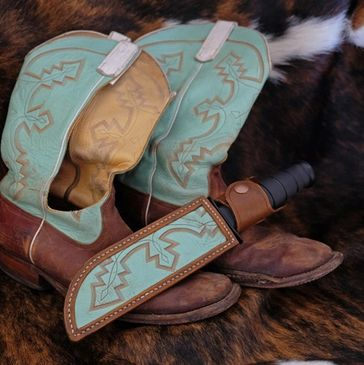 Knife sheath made from recycled cowboy boot.