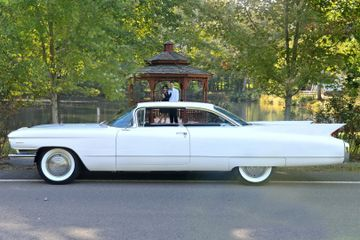 1960 Cadillac coupe white tailfins 1950s style fins rocket age refined wedding car for hire classic