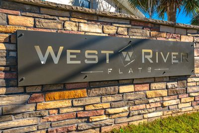 A picture of the signage outside West River Flats
