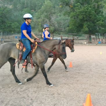 Students riding during a group lesson