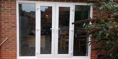 Outward opening UPVC French doors with 2 side panels fitted by Mansfield Front Doors in Mansfield.