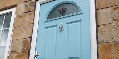 Duck Egg Blue 4 panel 1 arch Solid Core composite door fitted in Chesterfield.