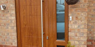 Golden Oak Solid Core door with a Golden Oak frame & matching mid rail side panel & Long Bar handle.
