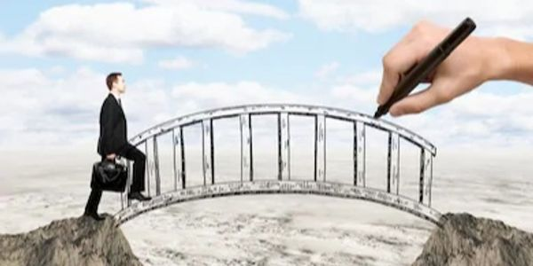 A man crossing a metaphorical bridge over a gap.
