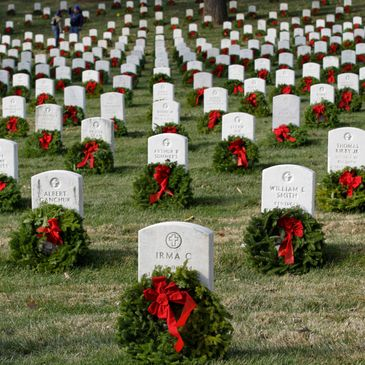 Graves with wreaths laid on them.