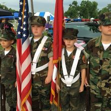 Young Marines standing ready for a Color Guard.