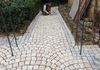 During installation of granite paver walkway in Opio