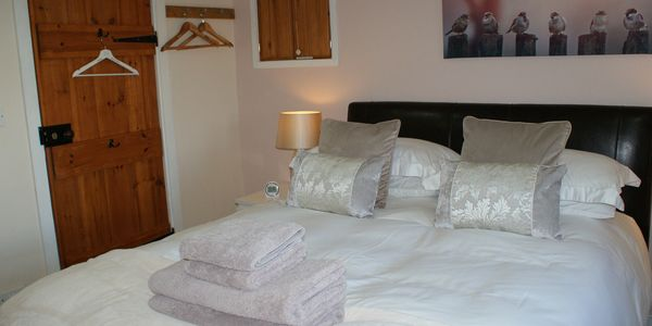 The second bedroom featuring a kingsize bed with a deep mattress and 800 thread count bed linen.