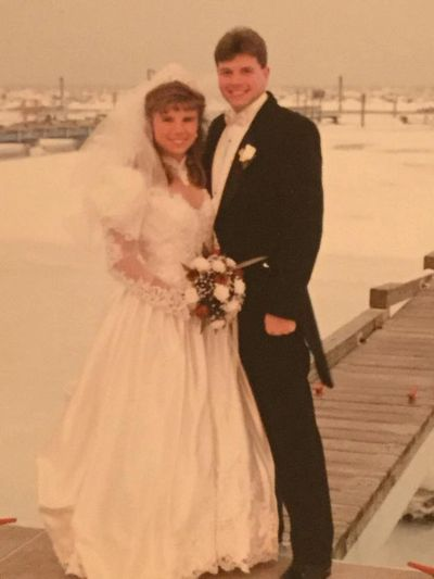 Classic 1990's white satin, beaded lace, BIG skirts and sleeves!  Alicia and Gary Turner, Jan. 1996.