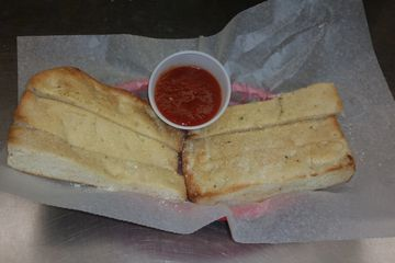 Our own breadsticks with our delicious sauce