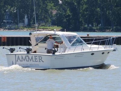 Jammer Sportfishing Salmon Fishing Charter boat entering the Port of Rochester, NY.