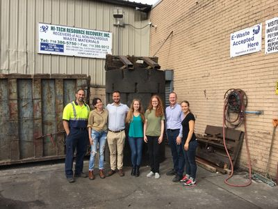 A group of Think Zero LLC team members with members of the Scholes Street Recycling Center team