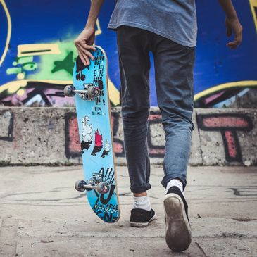 teen, adolescent with skateboard outside