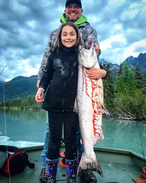King Chinook Salmon caught on a guided river boat fishing trip near Anchorage, Alaska with an all inclusive package. Max people on boat fishing charters is 6 people.
