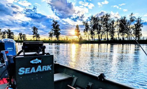 View from our King Chinook Salmon guided river fishing trip near Anchorage, Alaska with an all inclusive package. Max people on boat fishing charters is 6 people.