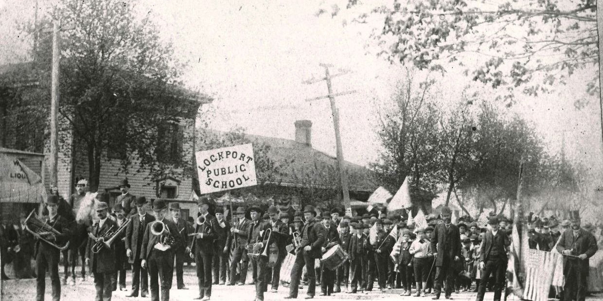 Lockport Public School in a parade [maybe around 1900]