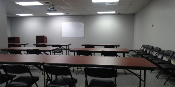 Office space for rent, huge training room with projector and audio equipment. Great for presenting to large groups, having large meetings or social events