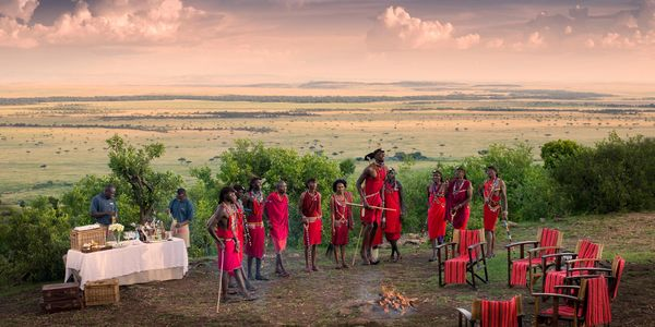 Masai tribesmen, sunset drinks, Masai Mara National Reserve, Kenya
