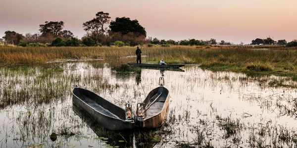 Mokoros at sunset, Okavango Delta Mobile Expedition, Botswana, Southern Africa