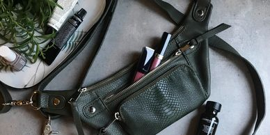 bumbags made with grained vegan leather, and green python-embossed vegan leather