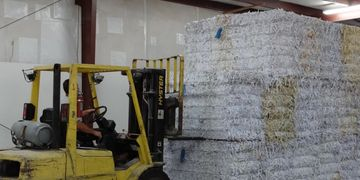 All shredded paper is baled and shipped to a manufacturing plant where it is recycled.