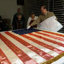 "Matt VanAcker, Co-Chair of ""Save the Flags"" shows our group the flag of the 6th Michigan Infantry."