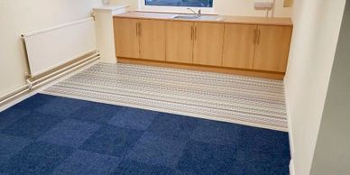 Vinyl and carpet tiles fitted to office space.