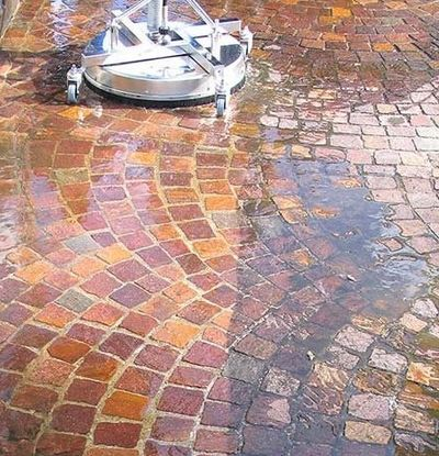 A mosmatic rotary surface cleaner working on block paving