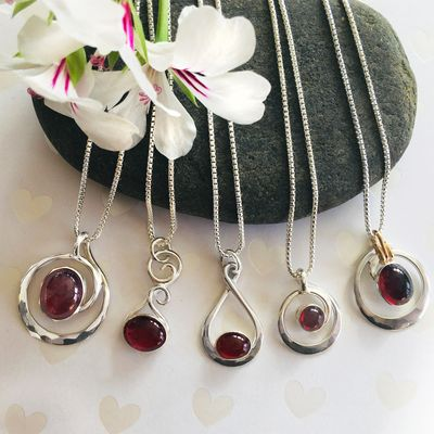Classic Ron Cravens Pendants shown in Garnets. Perfect styles for gift giving, Wedding parties and gifts to self!
