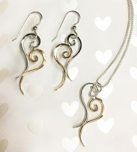 Handcrafted Heart Earrings and pendants set in Sterling Silver and 14K Gold Filled for a sweet combination.