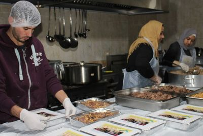 Our AIM staff preparing meals for Palestinian refugees near Beirut, Lebanon.
