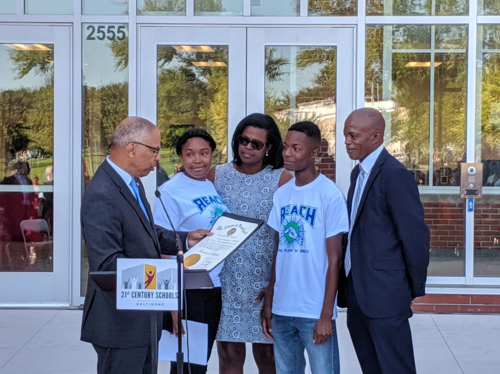 The renovated REACH! Partnership High School receives a gubernatorial citation.