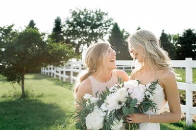 Bride with bridesmaid and wedding flowers