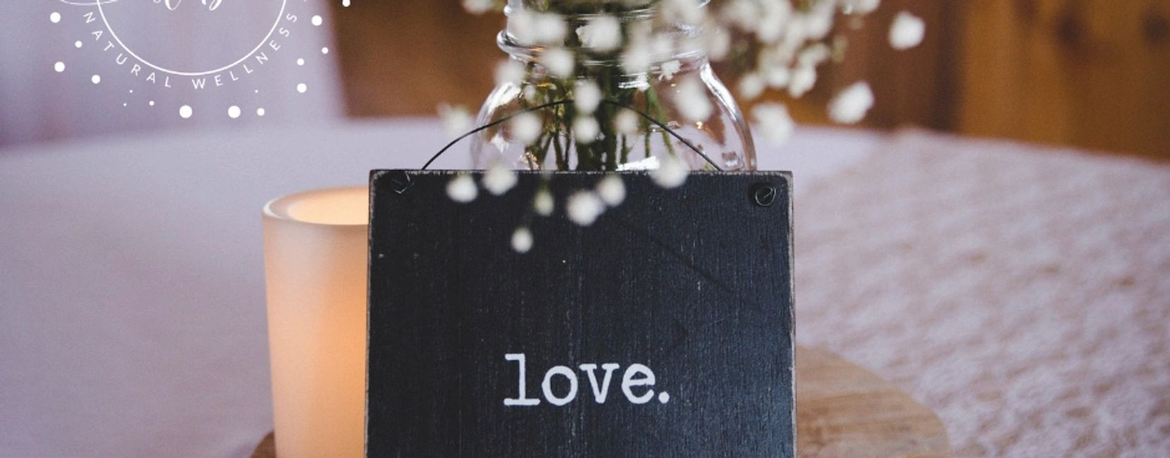 love word, candle, white flowers