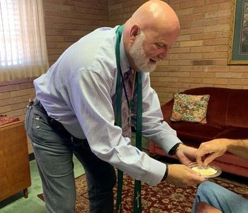 Pastor Joe Gambill presenting the bread during Mobile Communion on August 9,