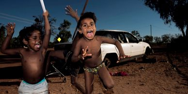 Photograph of australian aboriginal children playing in a remote community by Wayne Quilliam