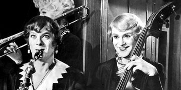 Tony Curtis (left) and Jack Lemmon (right) pretend to be women entertainers to escape the mob.