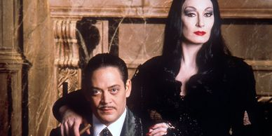 Angelica Huston and Raul Julia.