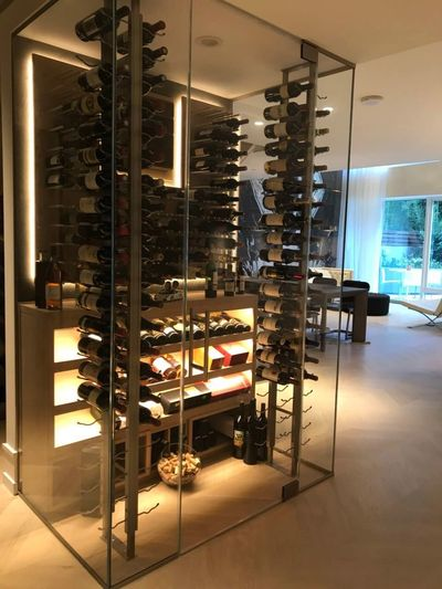 Wine display in San Francisco home. Combination of metal and wood racking.