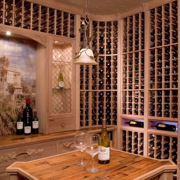Large room with wood racking and an island featuring wine barrel tabletop.