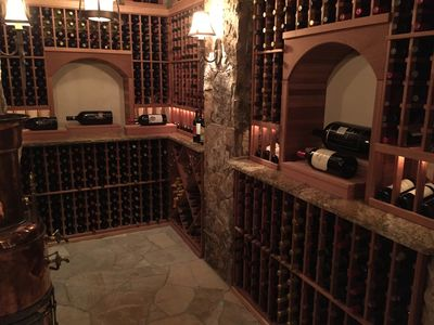 Wood wine cellar with stone floor and walls