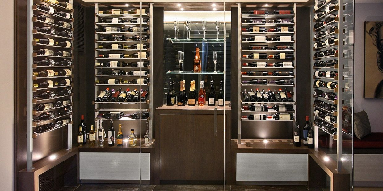 Rhino Wine Cellars modern metal and wood cellar with glass front. Metal horizontal bottle displays.