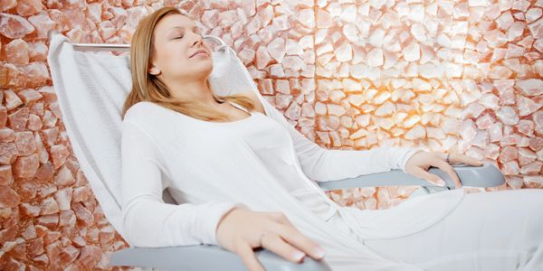 Woman realxing in chair during salt therapy session.