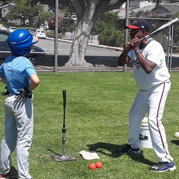 Coach Doc working on hitting at santa monica baseball academy