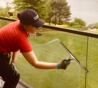 assistant cleaning glass railing