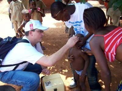 Lebanon Rotarian John Carr administers Polio vaccines in Africa