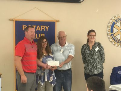 Summit Utilities donate $700 to the Lebanon Rotary Club's Koats for Kids Program.