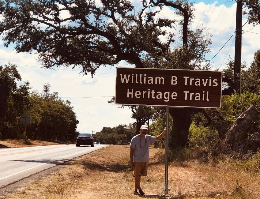 CaseyCutler with the Travis Heritage Trail Sign